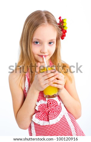 Portrait of happy little girl drinking orange juice. Isolated over white background.