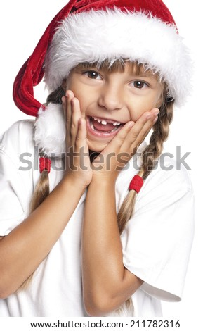 Portrait of happy little girl in Santa hat over white background - stock photo
