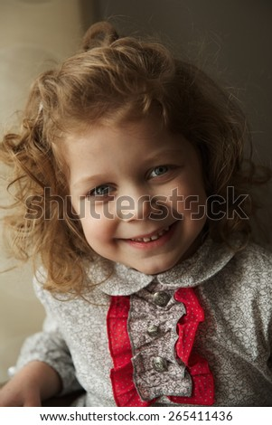 Portrait of happy little girl with curls
