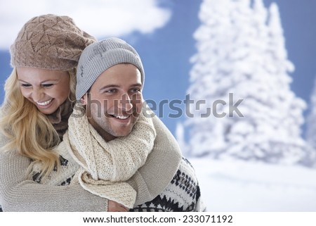 Portrait of happy loving couple embracing at wintertime outdoors. - stock photo
