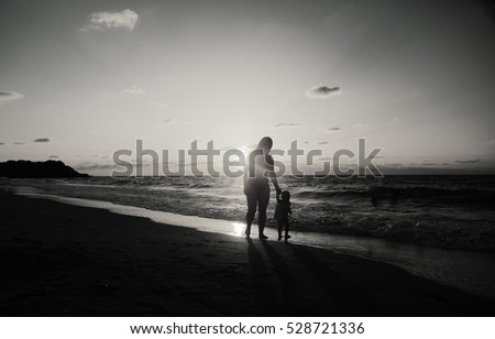 Portrait of happy loving mother and her baby at the beach