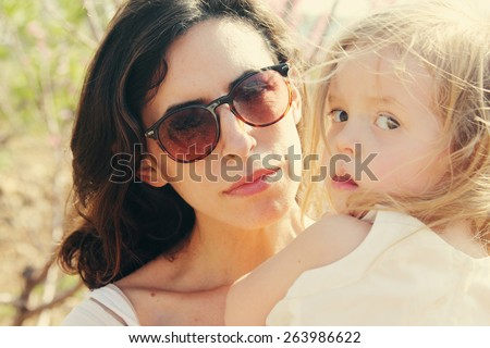 Portrait of happy loving mother and her daughter outdoors - stock photo