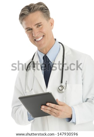 Portrait of happy male doctor holding digital tablet isolated over white background