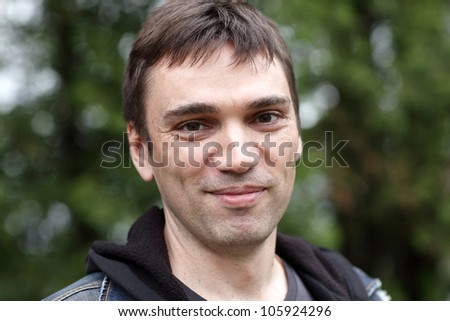Portrait of happy man in a park