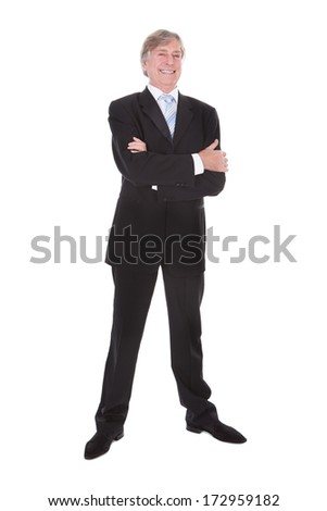 Portrait Of Happy Mature Businessman With Hand In Pocket Over White Background - stock photo