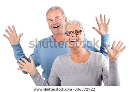 portrait of happy mature couple cheering on white Background, age and people concept - happy senior couple  - stock photo