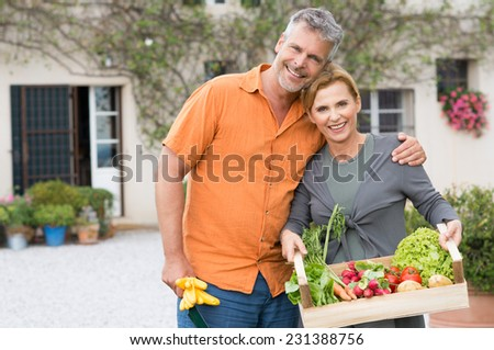 Portrait Of Happy Mature Couple With Vegetable - stock photo