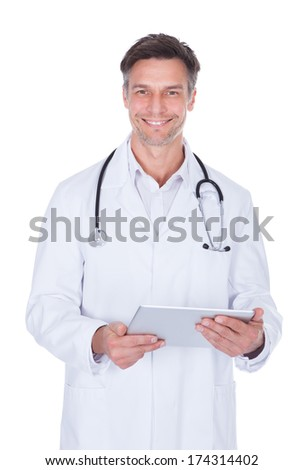 Portrait Of Happy Mature Male Doctor Holding Digital Tablet - stock photo
