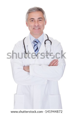 Portrait Of Happy Mature Male Doctor Isolated Over White Background - stock photo