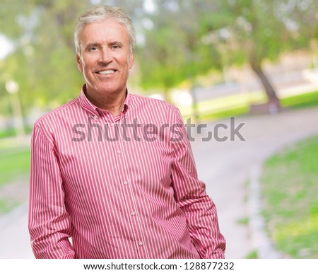 Portrait Of Happy Mature Man at a park - stock photo