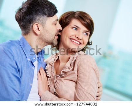 Portrait of happy middle aged couple
