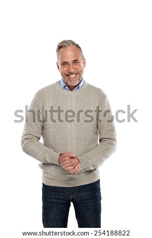 Portrait of happy middle aged man standing on white background - stock photo