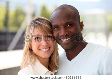 Portrait of happy mixed couple - stock photo