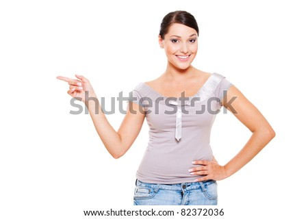 portrait of happy model pointing at something. isolated on white background - stock photo