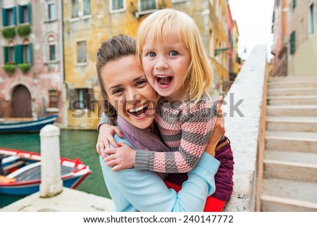 Portrait of happy mother and baby girl in venice, italy - stock photo