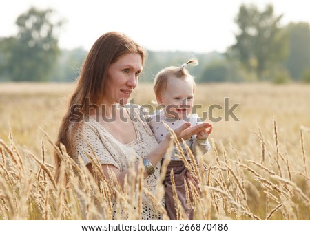 Portrait of happy mother and daughter outdoor  - stock photo