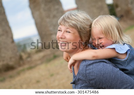 Portrait of happy mother and daughter, outdoor