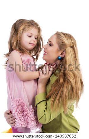 Portrait of happy mother and her adorable daughter isolated over white background