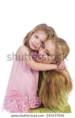 Portrait of happy mother and her little daughter embraced isolated over white background