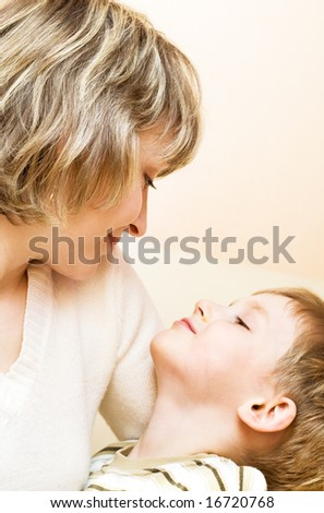 Portrait of happy mother and her son - stock photo