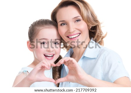 Portrait of happy mother and young daughter with heart shape sign  - isolated on background - stock photo