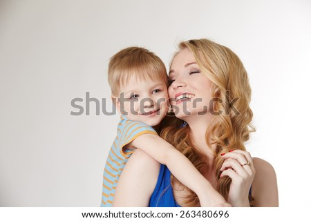 Portrait of happy mother hugging her son - stock photo