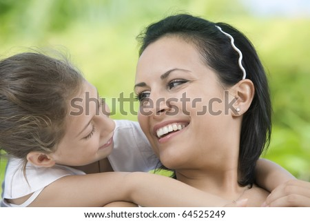 portrait of happy mother with daughter  having good time in summer environment - stock photo