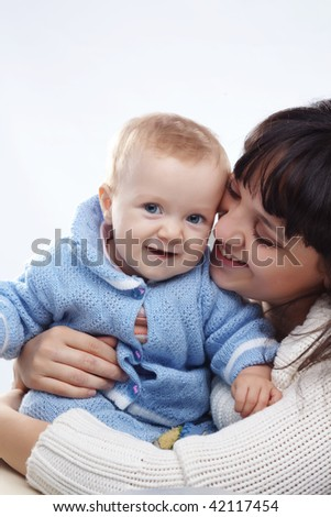Portrait of happy mother with her cute baby