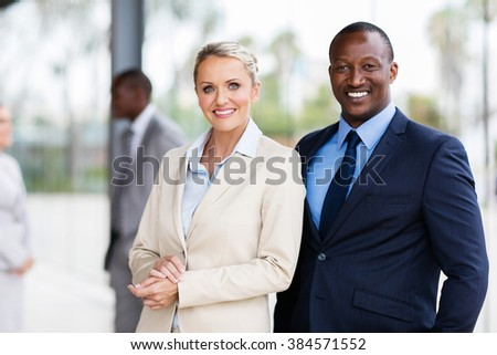 portrait of happy multiracial business partners - stock photo