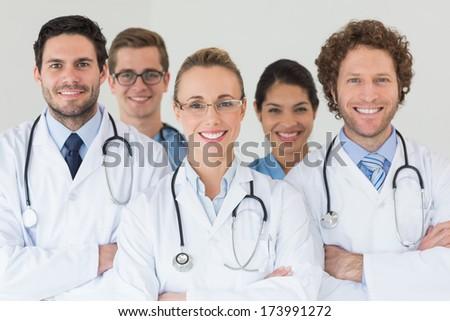 Portrait of happy nurses and doctors in hospital - stock photo