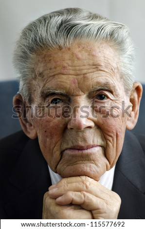 Portrait of happy old man in his 90's.  isolated on white background. Concept photo of senior citizen, retirement, pensioner, health and aging.