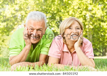 Portrait of happy old people relaxed in nature.