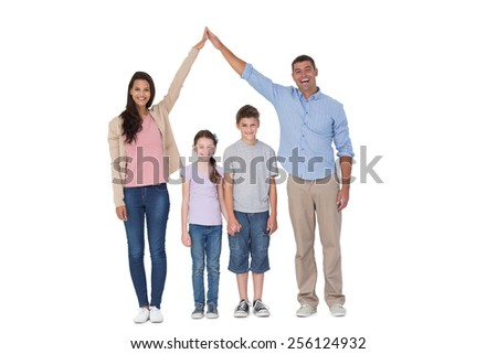 Portrait of happy parents joining hands above children against white background - stock photo