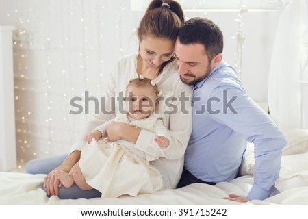 Portrait of happy parents with baby girl - stock photo