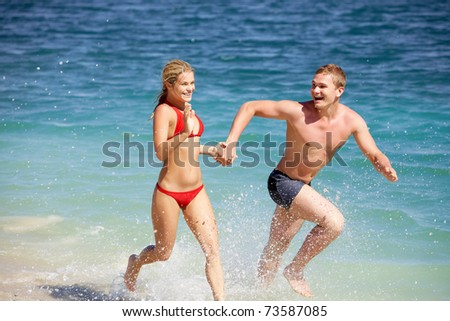 Portrait of happy people running together while summer vacation - stock photo