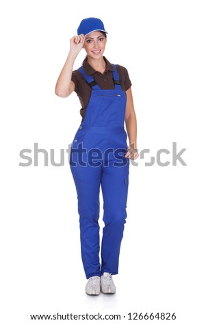 Portrait Of Happy Plumber While Holding Cap. Isolated On White - stock photo