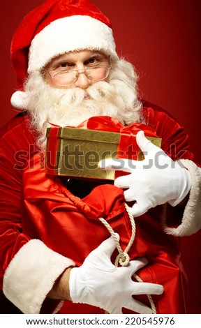 Portrait of happy Santa Claus holding big sack with presents - stock photo