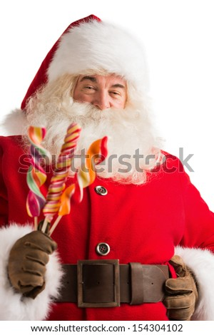 Portrait of happy Santa Claus holding candy looking at camera isolated on white background