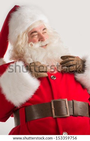Portrait of happy Santa Claus thinking and looking away