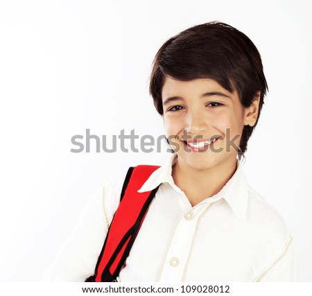 Portrait of happy schoolboy, beautiful clever brunette teenager isolated on white background, nice smart cheerful pupil standing with red knapsack, back to school, concept of knowledge and education