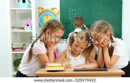 Portrait of happy schoolgirls at lesson