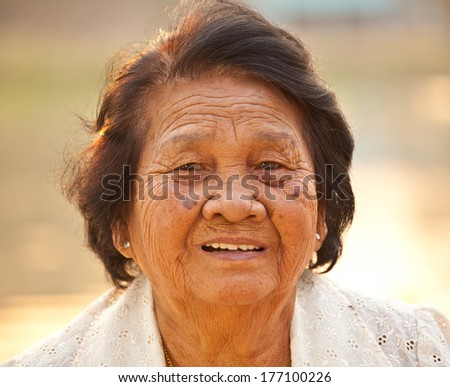 Portrait Of Happy Senior Asian Woman At Outdoor - stock photo
