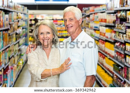 Portrait of happy senior couple at the supermarket
