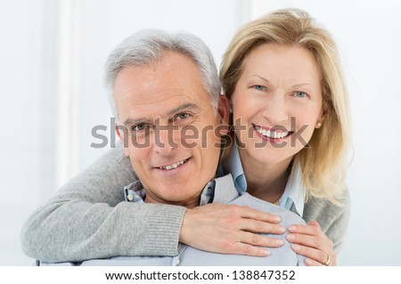 Portrait Of Happy Senior Couple Smiling at Home - stock photo