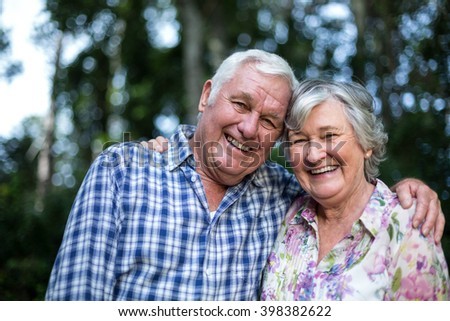 Portrait of happy senior man and woman in back yard - stock photo
