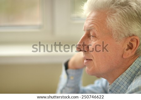 Portrait of happy senior man at home - stock photo