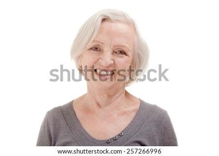 Portrait of Happy Senior Woman at the White Background - stock photo