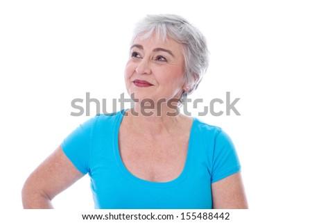 Portrait of happy senior woman looking up - stock photo