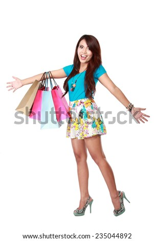portrait of happy shopping girl holding bags very happy expression. over white background