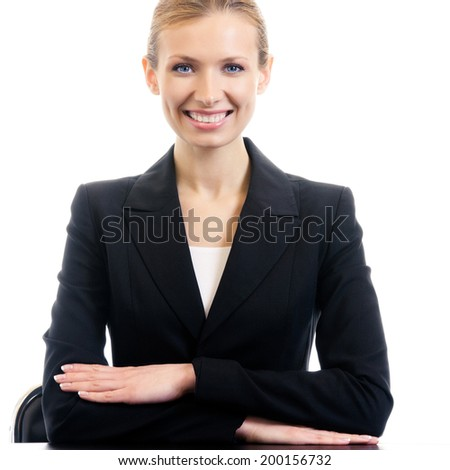 Portrait of happy sitting; smiling businesswoman at workplace, isolated on white background - stock photo